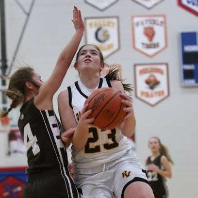 Paint Valley's Lexi Woods is fouled while shooting