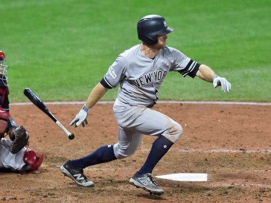 Oct 11, 2017; Cleveland, OH, USA; New York Yankees left fielder Brett Gardner (11) hits a 2-RBI single after a double-digit at-bat in the ninth inning during game five of the 2017 ALDS playoff baseball series against the Cleveland Indians at Progressive Field on Oct. 11, 2017