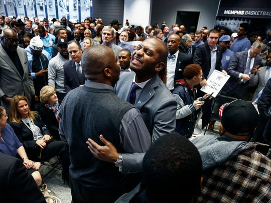 "Anfernee ""Penny"" Hardaway smiles while getting hugs"
