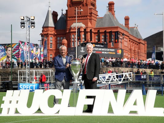 UEFA Ambassador and former Wales, Liverpool and Juventus soccer player Ian Rush, left, and Welsh First Minister Carwyn Jones pose with the Champions League Trophy in Cardiff, Wales  Thursday June 1, 2017 ahead of the final between Juventus and Real Madrid on Saturday. (Nick Potts/PA via AP)