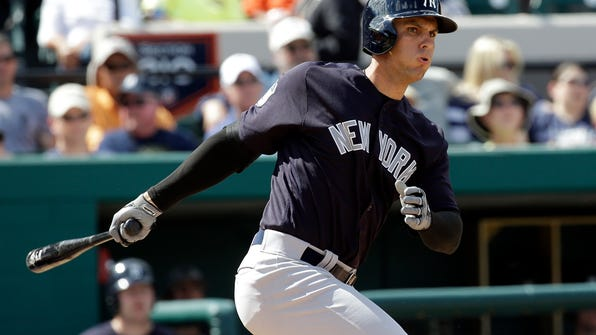 FILE - In this March 4, 2017, file photo, New York Yankees' Greg Bird bats against the Detroit Tigers in a spring training baseball game, in Lakeland, Fla. New York is looking for its first trip to the AL Division Series since 2012 behind a crew of rising young stars led by Gary Sanchez and Greg Bird. (AP Photo/John Raoux, File)