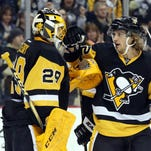 Pittsburgh Penguins goalie Marc-Andre Fleury (29) and