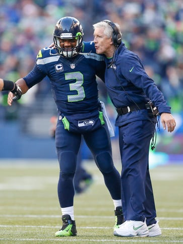 Seattle Seahawks quarterback Russell Wilson (3) and