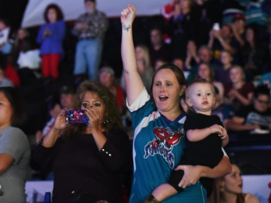 Mudbugs fans cheer during the first home game of the season at the Hirsch Coliseum Thursday evening.