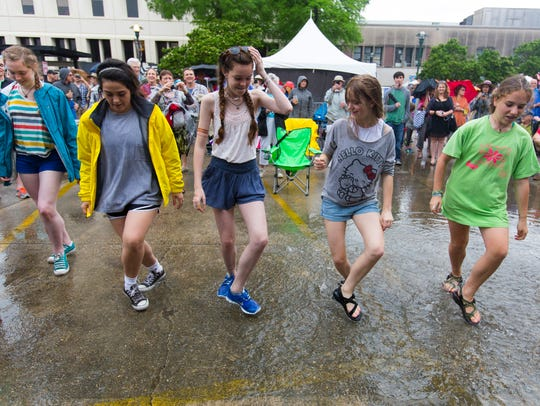 Dancers from New Orleans make the best of rain during