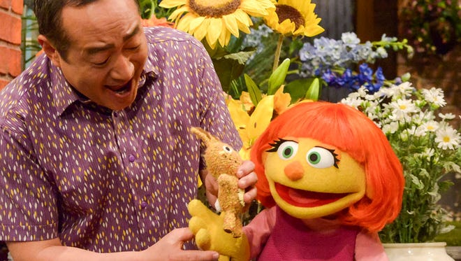 "This image released by Sesame Workshop shows Julia, a new autistic muppet character debuting on the 47th Season of ""Sesame Street,"" on April 10, 2017, on both PBS and HBO.  Under President Donald Trump's budget plan, funding for the Corporation for Public Broadcasting, which created Sesame Street, would be cut. (Zach Hyman/Sesame Workshop via AP)"