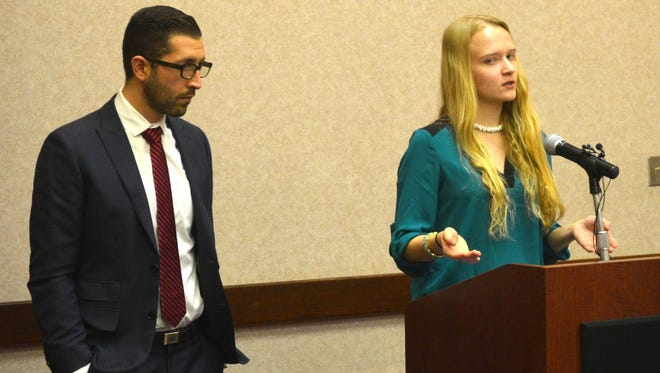 Emily Kollaritsch stands alongside her lawyer, Alex Zalkin, during a news conference Nov. 18, 2015,  announcing a new Title IX civil lawsuit against Michigan State University.