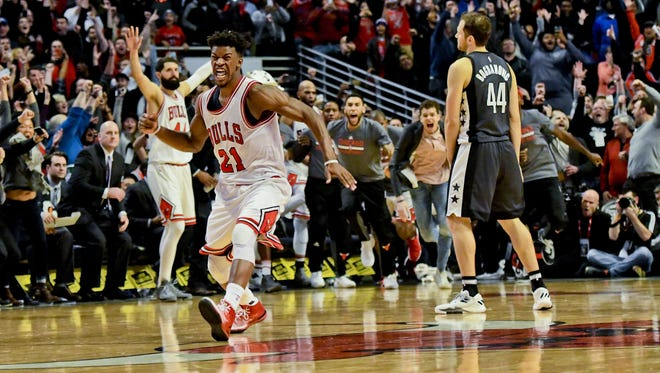 Chicago Bulls forward Jimmy Butler, left, reacts after scoring the game winning basket against the Brooklyn Nets at the end Wednesday, Dec. 28, 2016, in Chicago.