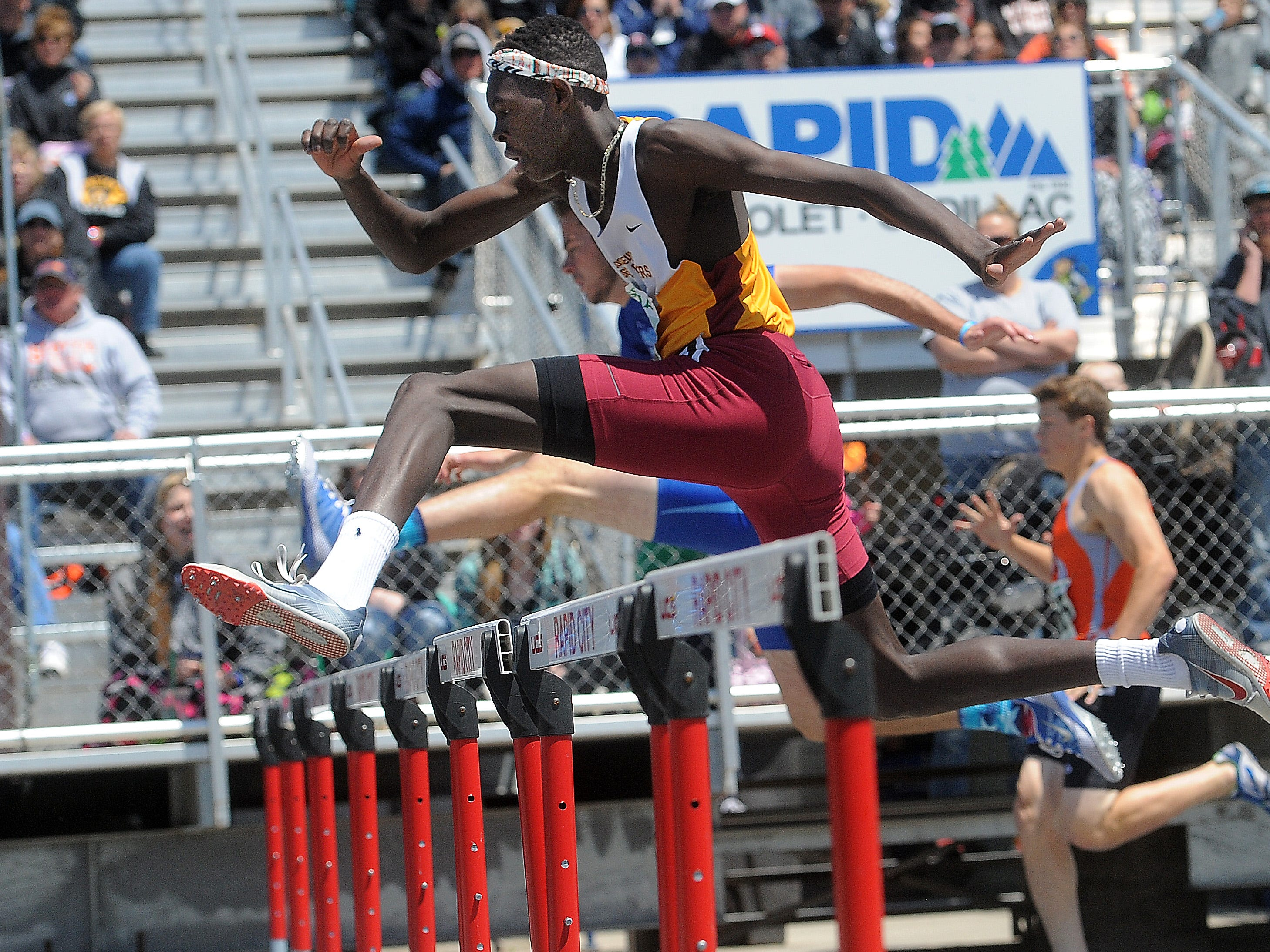 Roosevelt's Mayuen Akok race to victory Saturday in Rapid City in the 300 hurdles. His time was 39.72 seconds. He later helped the Rough Riders to a win in the 800 relay.