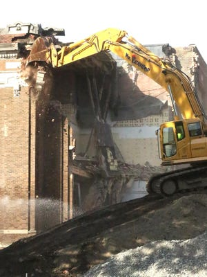 Work begins Tuesday to demolish the old Dover High School building on N. Walnut Street.