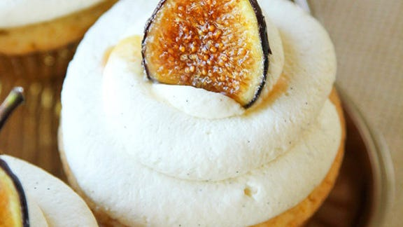 Honey cupcakes with mascarpone frosting and caramelized figs.