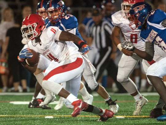 Rancocas Valley's Iverson Clement runs the ball during the 2nd quarter of Thursday night's football game between Rancocas Valley and Washington Township, played at Washington Township High School.