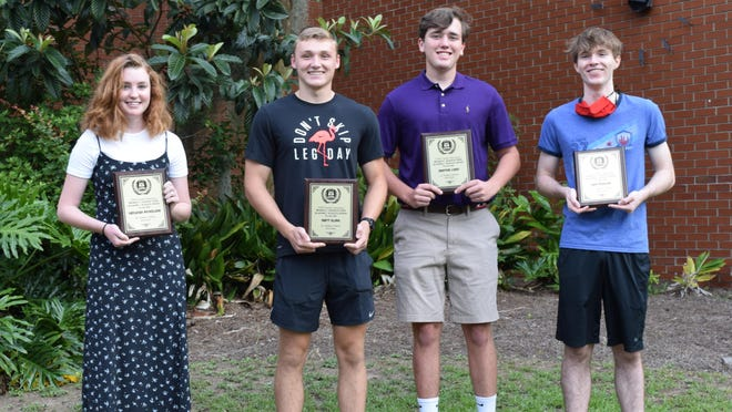 Cayleigh Nicholson, Matt Eling, Denton Lord, and Sam Perkins (pictured l to r) all received the received the Morris C. Johnson Academic Athlete Award last week.