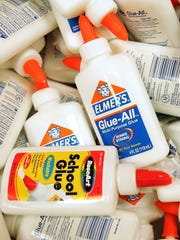 Glue is displayed in a back-to-school section of a