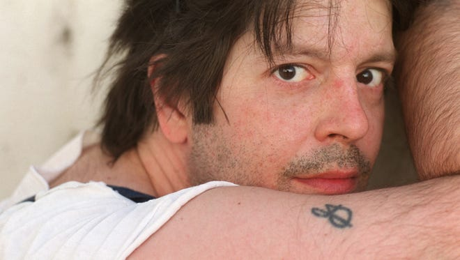 In this May 2000 photo, former Husker Du drummer Grant Hart poses for a photo in Minneapolis. Ken Shipley, who runs the band's record label Numero Group, told The Associated Press that Hart died at the age of 56 on Wednesday, Sept. 13, of cancer at his home in St. Paul.
