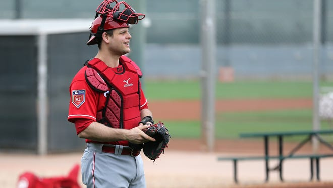 Cincinnati Reds catcher Devin Mesoraco (39) smiles before a bullpen session, Wednesday, Feb. 14, 2018, at the Cincinnati Reds Spring Training facility in Goodyear, Arizona.