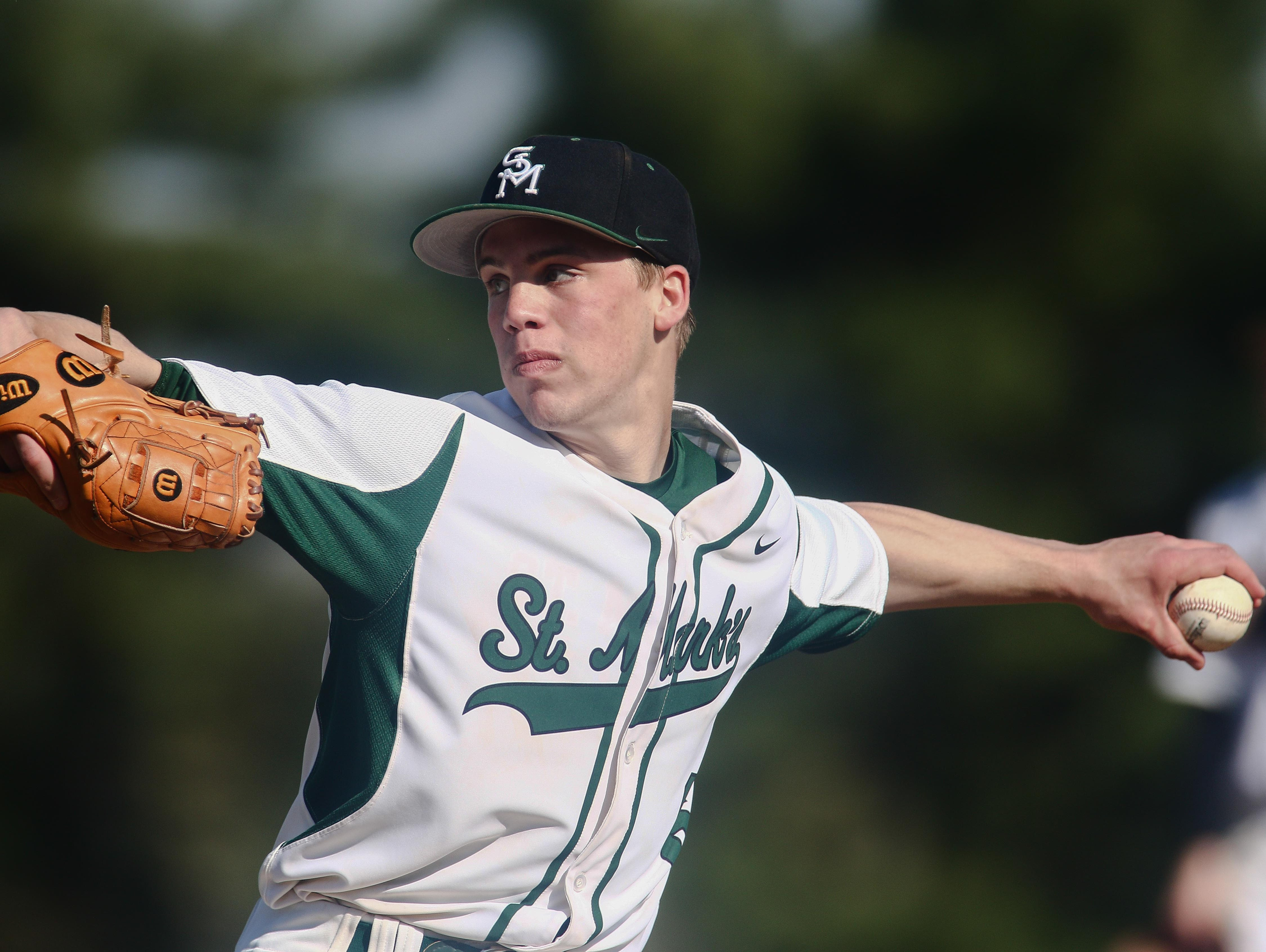 St. Mark's Andrew Reich (6) throws a strike Thursday.