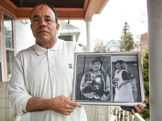 Eufracio Torres holds a photo of his daughter, Abigail