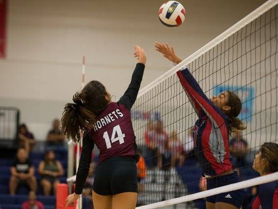 Flour Bluff's Cali Nims hits the ball over the net