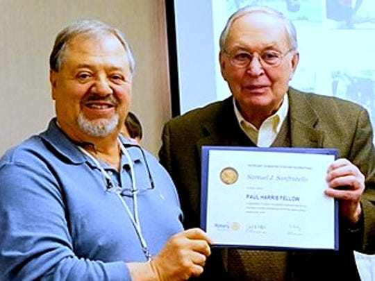 Corning Rotarian Dick Pope, right, presents the Paul