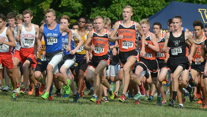 The pack surges forward at the start of the boys' portion of the boys 11-12 grade race on Sept. 1 at the Mustang Invitational held at Cass Benton Park.