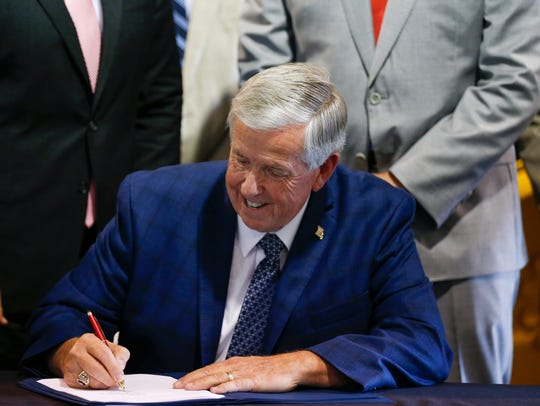 Missouri Gov. Mike Parson signs House Bill 2540, which