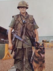 Jim Botts with his dog Roland in Vietnam. Botts served