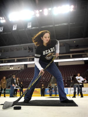 Lebanon resident Eileen Daub practices her slapshot during Hockey in Heels at the Giant Center earlier this week. The Hershey Bears Hockey Team held the 3rd Annual Hockey & Heels event  at the Giant Center on Thursday,  Jan. 15, hosting approximately 200 women who wanted to learn more about the game. Participants had the opportunity to practice on ice passing, shooting, locker room tours, an alumni session, and dinner with drinks.