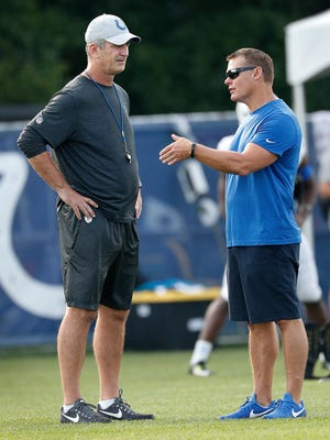 Indianapolis Colts head coach Frank Reich talks with Colts GM Chris Ballard during their ninth day of training camp at Grand Park in Westfield on Sunday, August 5, 2018.