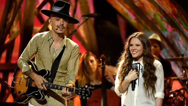 Jesse Huerta, left, and Joy Huerta of Jesse & Joy perform during the 2016 Latin American Music Awards at Dolby Theatre on Oct. 6, 2016, in Hollywood. The duo has four nominations for the 2016 Latin Grammys on Thursday, Nov. 17, 2016.