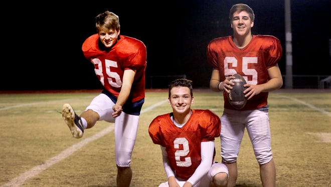 Oakland's kicking team (L to R) Aaron Sears, kicker; Brevin Linnell, holder and Patrick Leonard, snapper, on Tuesday, Nov. 29, 2016.
