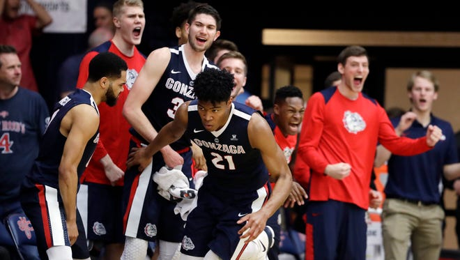 Players on the Gonzaga bench celebrate after forward Rui Hachimura (21) scored against Saint Mary's during the second half of an NCAA college basketball game Saturday, Feb. 10, 2018, in Moraga, Calif. (AP Photo/Marcio Jose Sanchez)