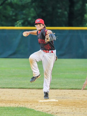 Rye's Griffin Tutun looks to turn a double play at the NY State Class A finals against Bayport-Blue Point at Union Endicott, June 14, 2014.
