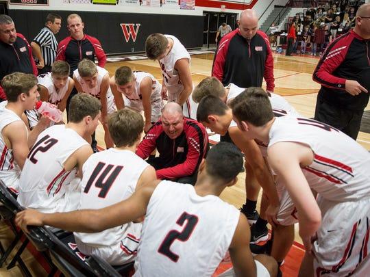 Wapahani's head coach Matt Luce talks to the team during