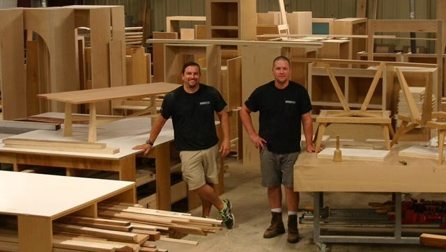 Scott Moore, left, and Chad Austin own ABM, based in Franklin. The company handles small cabinetwork and furniture projects, as well as custom woodworking.