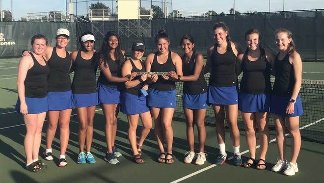 The Castle girls' tennis team celebrates its first regional title since 1999.