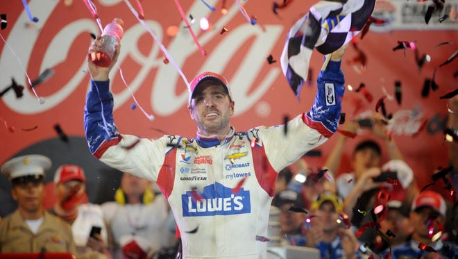 NASCAR Sprint Cup Series driver Jimmie Johnson (48) celebrates in victory lane after winning the Coca-Cola 600 at Charlotte Motor Speedway.
