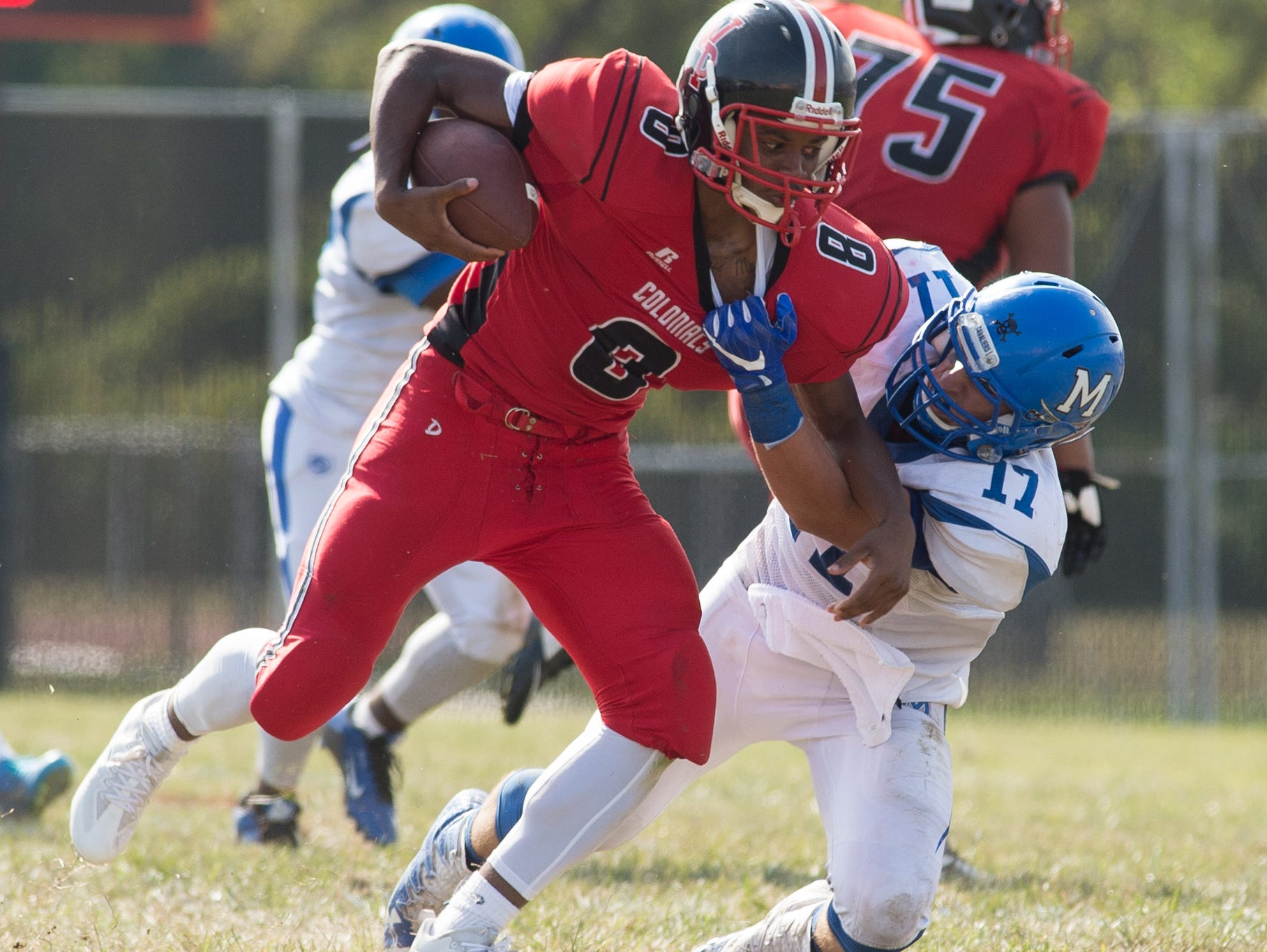 William Penn's Michael Mills (8) is tackled by Middletown's Spencer Harbert (17).