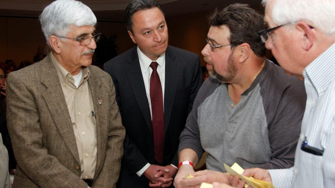 From left, Stafford Township Mayor John Spodofora and Councilman Henry Mancini listen to the voting results from judges Dave Patti and Lou Castelli at the Stafford Township Republican Club nomination meeting at the Holiday Inn in Stafford Monday.