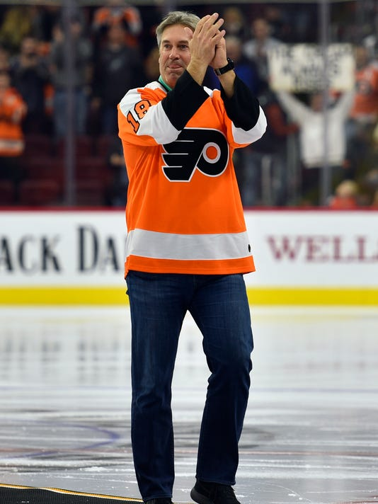 Philadelphia Eagles coach Doug Pederson applauds after a ceremonial puck drop at an NHL hockey game between the Philadelphia Flyers and the Tampa Bay Lightning, Thursday, Jan. 25, 2018, in Philadelphia. (AP Photo/Derik Hamilton)