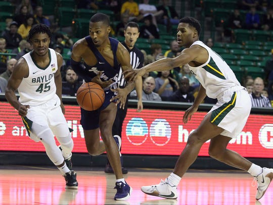 Jackson State guard Jonas James (3) drives against Baylor guard Jared Butler (12) and Davion Mitchell (45) in the first half of an NCAA college basketball game, Monday, Dec. 30, 2019, in Waco, Texas. (AP Photo/Jerry Larson)