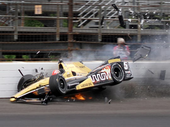 James Hinchcliffe (5) hits the wall coming out of turn