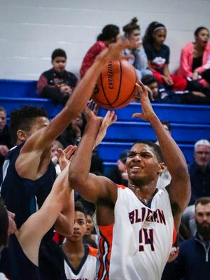 Blackman Middle's Javon Nelson attempts a shot in traffic during Thursday's county title game.