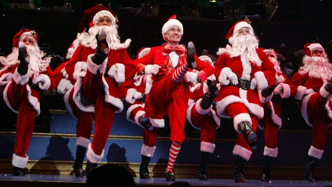 Dancing Santas took to the Hilbert Circle Theatre stage during the 2011 IPL Yuletide Celebration.