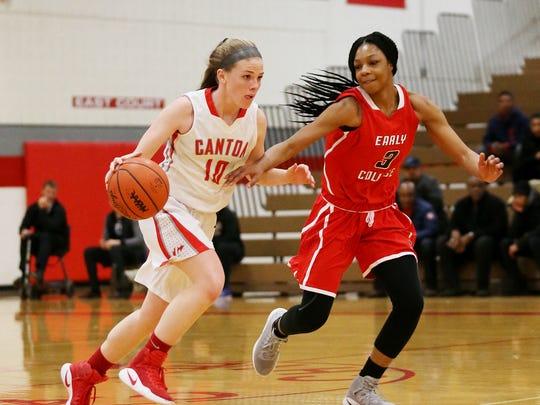 Canton's Alaina Heitmeyer (10) goes one-on-one against Detroit Edison's Gabrielle Elliot (3).