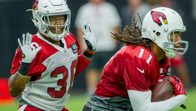 Arizona Cardinals cornerback Brandon Williams (26) reacts after the whistle is called after tackling Arizona Cardinals wide receiver Larry Fitzgerald (11) on July 28, 2018, during the Arizona Cardinals training camp at the University of Phoenix Stadium in Glendale, Arizona.