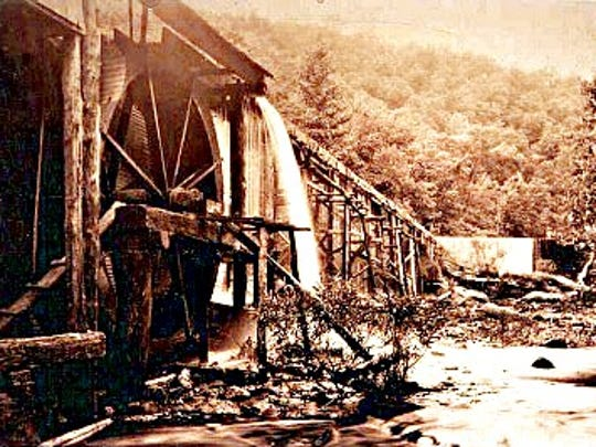 A flume and overshot mill with wheel.