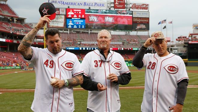 Former Cincinnati Reds trio known as the Nasty Boys Rob Dibble, left Norm Charlton  and Randy Myers prepare to throw out the ceremonial first pitch prior to the game against the Chicago Cubs at Great American Ball Park.
