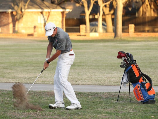 San Angelo Central High School senior Jansen Smith blasts an approach shot during the second round of the 2018 San Angelo Boys Golf Classic at Bentwood Country Club on Friday, March 9, 2018.