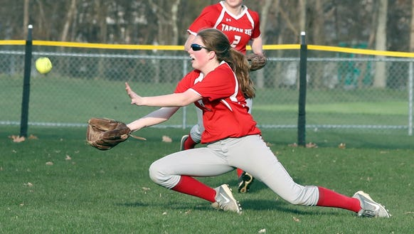Megan Coyle of Tappan Zee makes a diving catch on a